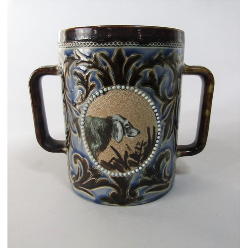 1025 - An  unusual Doulton Lambeth loving cup by Hannah B Barlow with two reserved oval panels with painted...