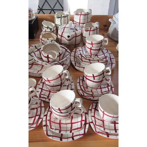 1031 - A collection of Midwinter Stylecraft Homeweave wares designed by Jessie Tait, mainly in the red colo...