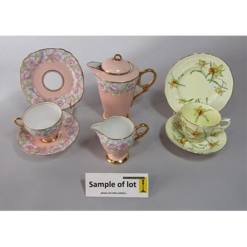 1036 - A collection of Royal Stafford tea wares in the art deco manner with floral decoration on a peach co...