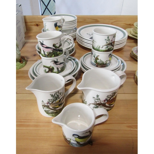 1038 - A collection of Portmerion Birds of Britain wares comprising three jugs, six cups, six saucers, six ...