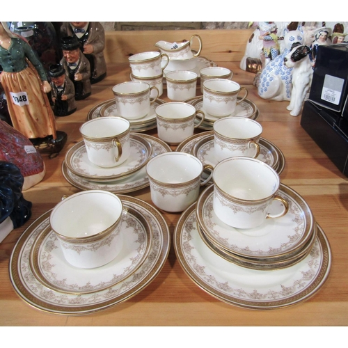 1046 - A collection of Aynsley teawares with gilt border decoration including cake plate, milk jug, sugar b...