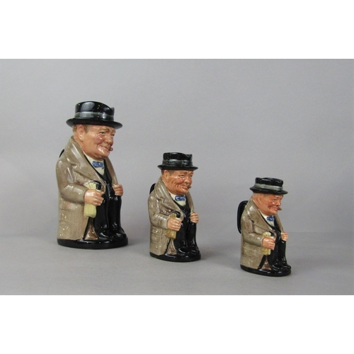 1047 - A graduated set of three Royal Doulton Toby jugs in the form of Winston Churchill (3)...