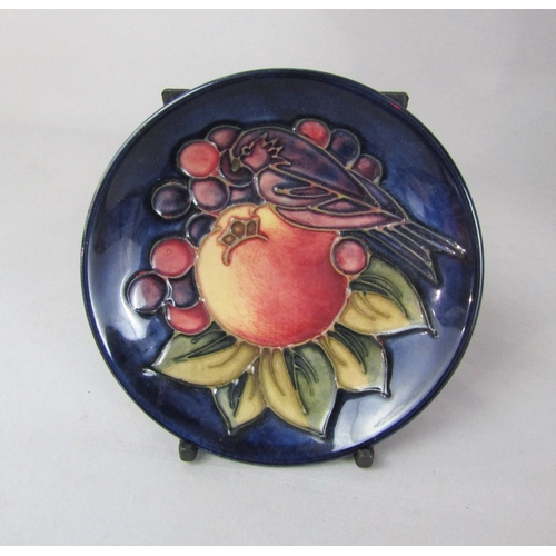 1049 - A Moorcroft plate in the Finch and Fruit pattern with impressed marks to base and painted initials, ...
