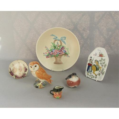A Clarice Cliff cream ground wall plate with relief moulded and painted flower basket and ribbon detail, with printed mark to base and further marked 825, 23.5cm approx diameter, together with a small early 20th century Satsuma dish with painted and gilded Wisteria decoration and red and gilt seal mark to reverse, 9cm approx diameter, a Royal Copenhagen robin, a Beswick Barn Owl, number 2026, a Norwegian Norge wall plaque with printed decoration of a man and his horse, etc (6)
