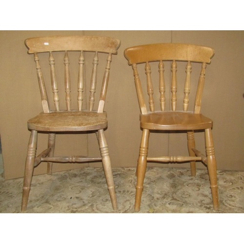 A set of four contemporary Windsor beechwood kitchen chairs with turned spindlebacks