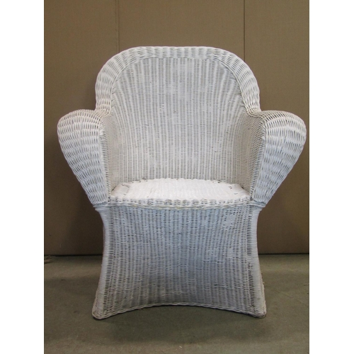 2057 - A vintage wicker chair with shaped outline and cream painted finish...