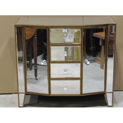 A contemporary shallow breakfront side cabinet with segmented bevelled edge mirror panels enclosed by a tower of four central drawers flanked by cupboards raised on tapered supports 91 cm wide x 41 cm deep x 81 cm in height