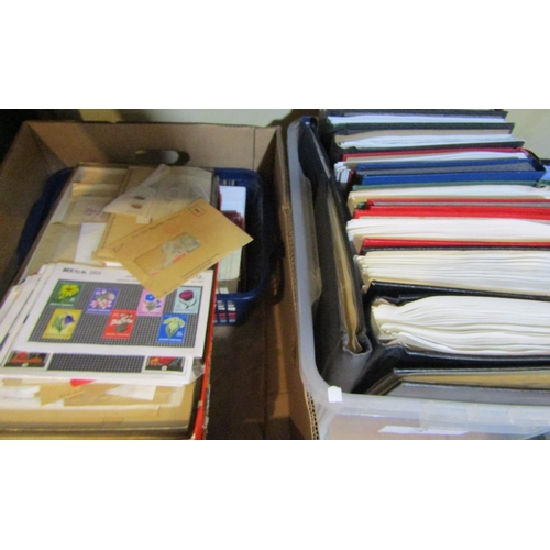1829 - Two boxes containing a large quantity of albums with a mix of world, mint and used stamps, loose sta...