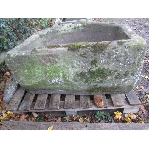 2004 - A large and deep weathered natural stone D shaped garden trough with canted corner, approx 95 cm wid...