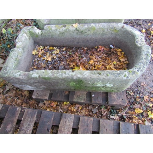 2005 - A weathered natural stone trough of rectangular form with single D end and four notched channels, 10...