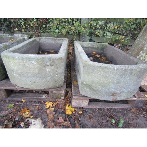 2006 - A pair of weathered natural stone troughs of rectangular form with single D ends and notched channel...