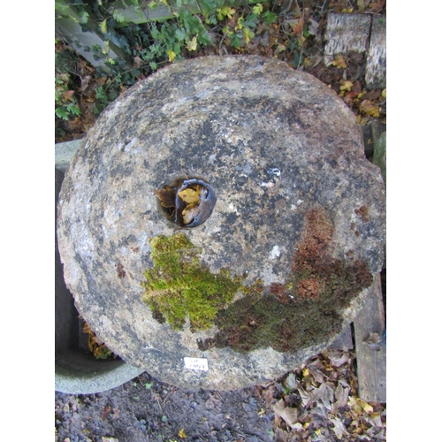 2007 - A weathered natural stone staddlestone of square tapered form with domed cap approx 80 cm high...