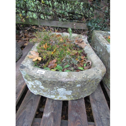 2008 - A weathered natural stone trough of rectangular form with single rounded end, 72 cm long x 46 cm wid...