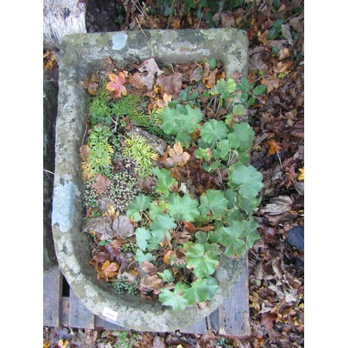 2009 - A weathered natural stone trough of rectangular form with single D end, 80 cm long x 53 cm wide x 26...