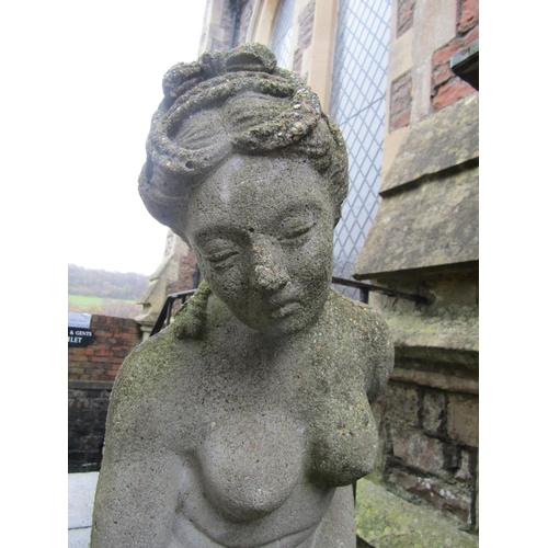 2010 - A weathered cast composition stone garden figure of a classically draped maiden, 104 cm in height...