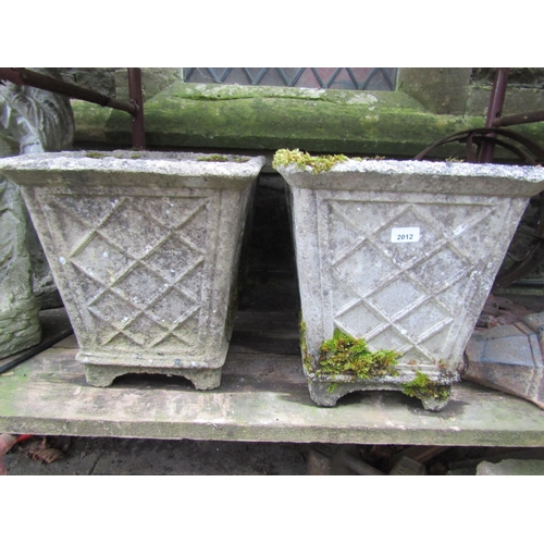 2012 - A set of four weathered cast composition stone garden planters of square tapered form with simulated...