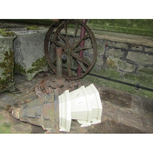 2013 - A pair of small iron implement wheels 46 cm in diameter, four reclaimed cast iron drain water hopper...