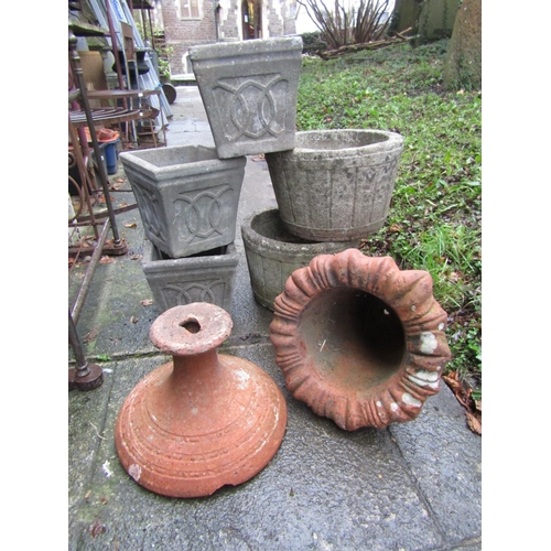 2015 - A weathered terracotta foliate bell shaped garden urn (AF), together with a pair of weathered compos...