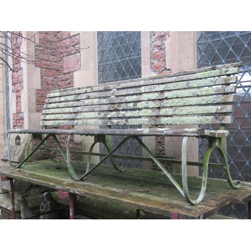 2016 - A sprung steel park/garden bench with weathered timber lathes and green painted finish, 8ft long...