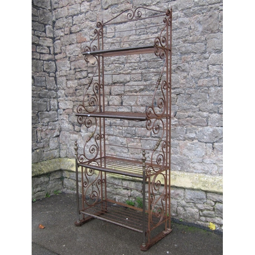 2019 - An iron framed freestanding four tier bakers stand with decorative scroll work detail, 85 cm wide x ...
