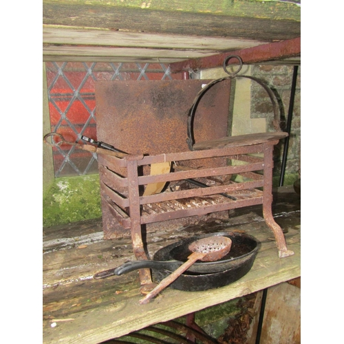 2022 - A small wrought and cast iron fire basket of rectangular form 46 cm wide, contents to include a cast...