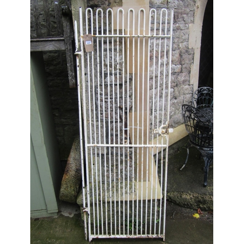 2025 - A wrought iron pedestrian gate with slender hooped vertical bars, sliding latch and painted finish, ...