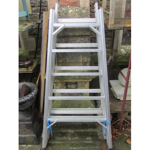2028 - Two aluminium folding trestles including a Lansford example...