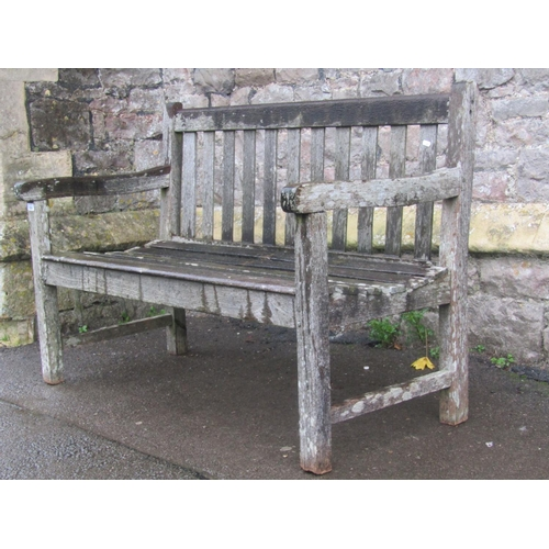 2036 - A weathered teak two seat garden bench with slatted seat and back (AF), 120 cm long...