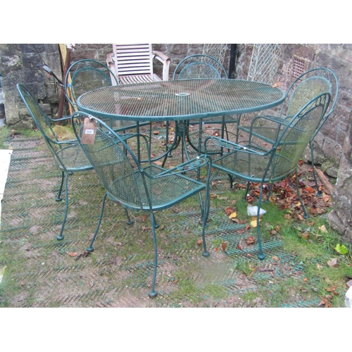 2049 - A green painted light steel seven piece garden suite with lattice, simple scroll and foliate detail,...