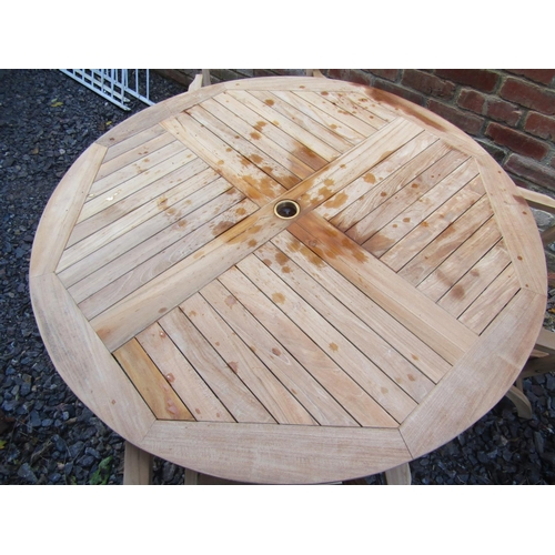 2038 - A good quality contemporary teak garden table of circular form with segmented and slatted top raised...