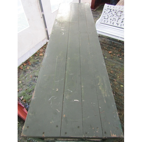 2055 - A vintage green painted wooden work bench, fitted with four frieze drawers, raised on square cut sup...