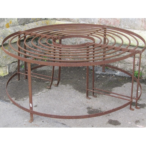 2026 - An old ironwork two sectional tree seat with strap and rod framework approx 4ft in diameter...