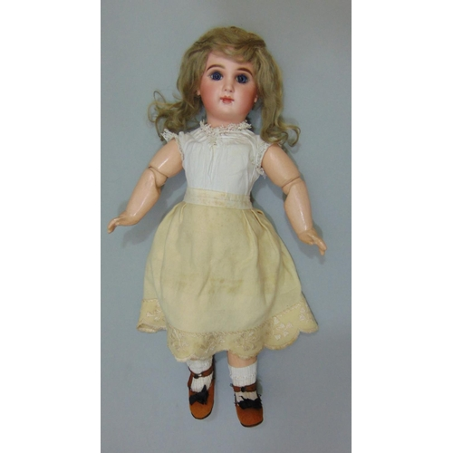 15 - Jumeau bisque socket head doll with jointed composition body, with fixed blue eyes, painted lashes, ...