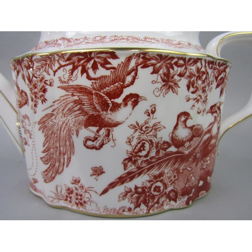1001 - An extensive collection of Royal Crown Derby Red Aves pattern ware including two oval graduated meat...