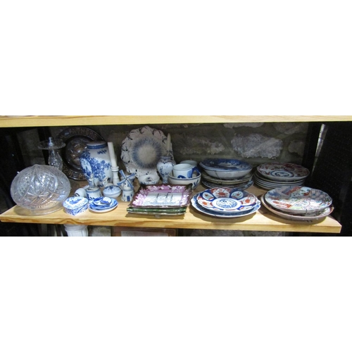 1002 - A collection of ceramics including 19th century and later oriental dishes including imari type examp...