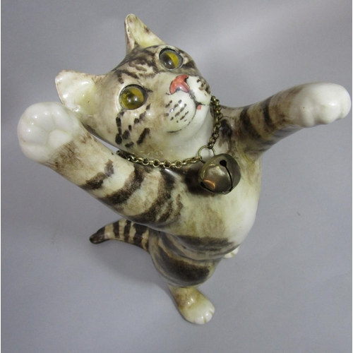 1006 - An unusual Winstanley model of a tabby cat standing on its hind legs, 34cm tall approx, together wit...