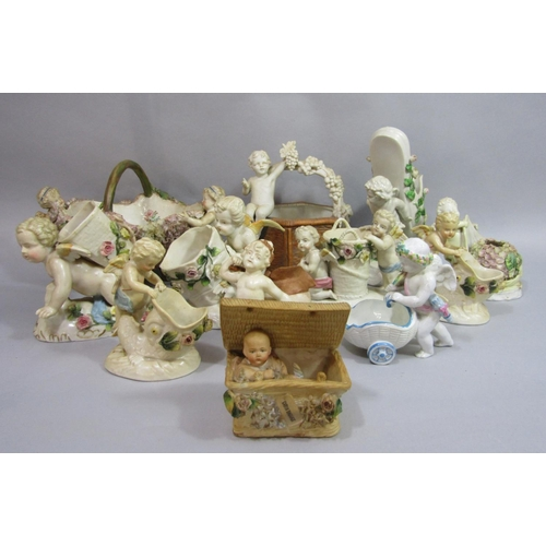 1019 - A collection of mainly late 19th century continental ornaments in the form of cherubs including a he...