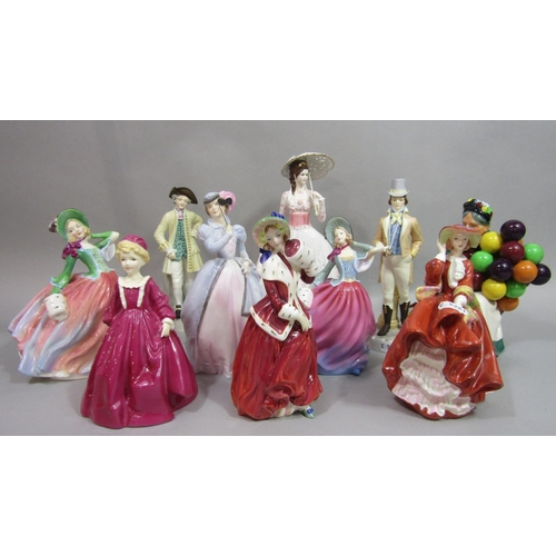 1020 - A collection of Royal Doulton figures including Autumn Breeze HN4716, Top O'The Hill, Christmas Morn...