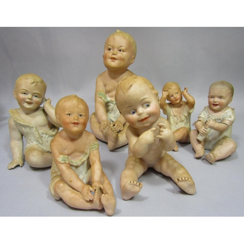 1030 - A collection of late 19th century and early 20th century continental bisque figures of the piano bab...