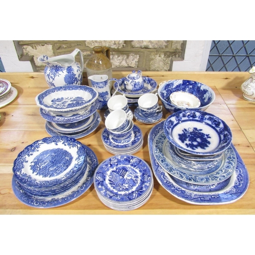 1040 - A quantity of blue and white printed wares including Copeland Spode Italian pattern flatback wall ha...