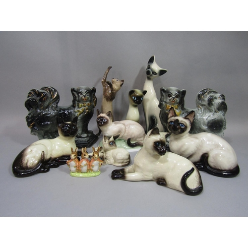 1041 - A collection of models of Siamese cats including Beswick and Royal Doulton examples, example by Fran...