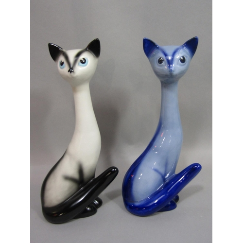 1043 - Two Sylvac models of seated Siamese cats with elongated necks, both with impressed numbers to base 3...
