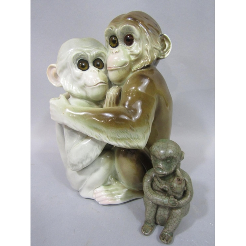 1051 - A continental group of a pair of embracing monkeys, both with glass eyes and impressed marks to reve...
