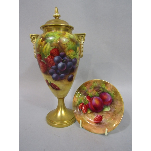 1054 - A Royal Worcester Blush Ivory urn shaped vase and cover with painted grape, strawberry and blackberr...