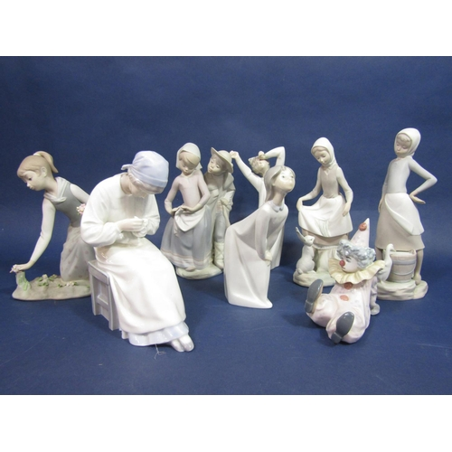 1015 - A Danish B&G figure of a young female ceramic artist (af to neck) together with four matt glazed Lla...