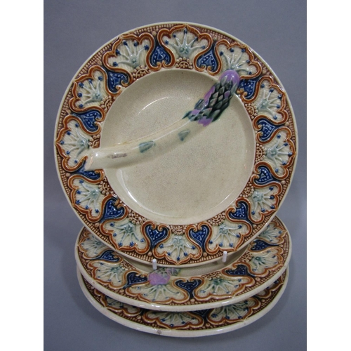 1014 - A set of five 19th century majolica asparagus serving plates, with simulated asparagus mouldings and...
