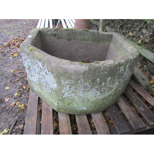 2003 - A large and deep weathered natural stone D shaped garden trough with canted corner, approx 95 cm wid...