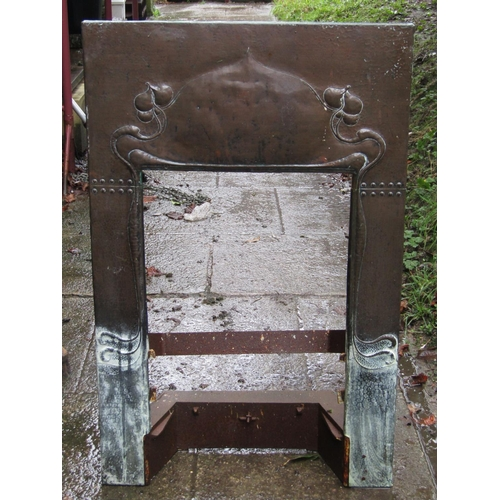 2008 - An Art Nouveau copper clad fire insert with foliate and hammered detail, 61 cm wide x 97 cm in heigh...