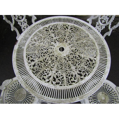 2012 - A cream painted cast aluminium garden terrace table of circular form with decorative pierced top and...