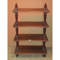 A 19th century walnut etagere on four rectangular tiers with fluted baluster supports and turned feet, 62 cm wide x 36 cm deep x 100 cm in height